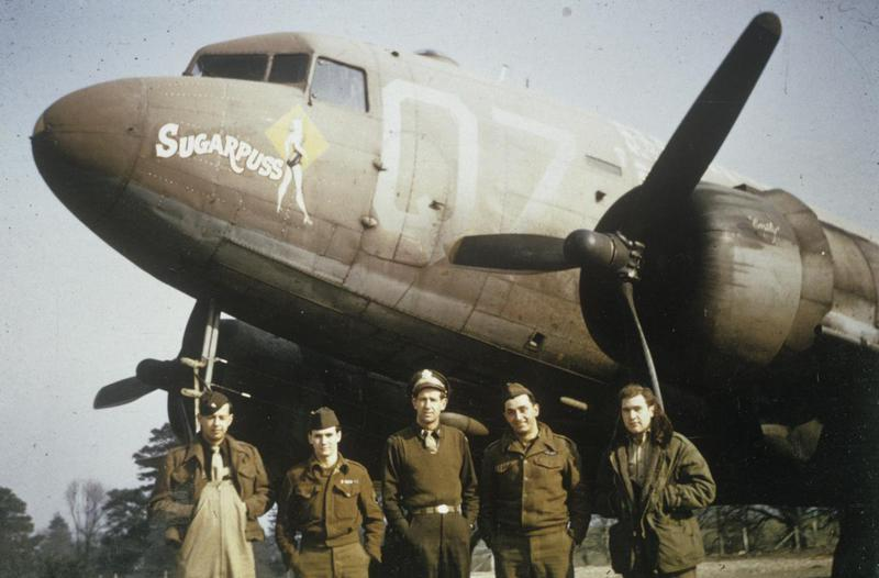 Lieutenant Gilbert Estelle (centre), a pilot of the 438th Troop Carrier Group with his crew and their C-47 Skytrain nicknamed