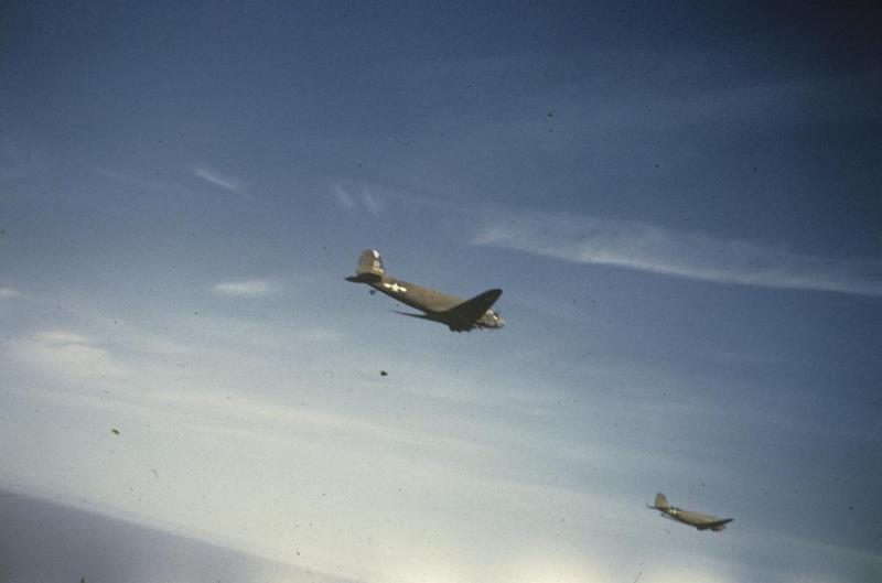 Two C-47 Skytrains of the 439th Troop Carrier Group fly over Debden in 1944. Image via Ed Ritchie. Written on slide casing: 'C47 Over Debden.'