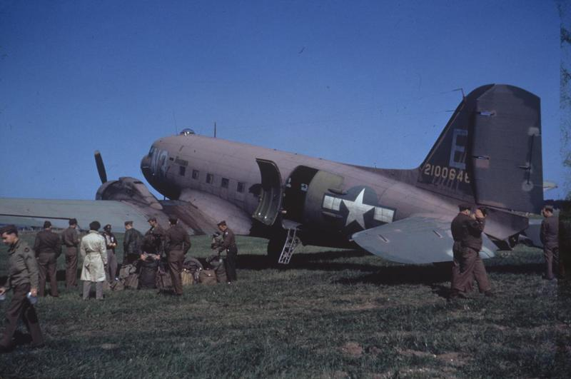 Personnel prepare to board a C-47 Skytrain (serial number 42-100646) of the 313rd Troop Carrier Group at Nordholz. Image via John Quincy.