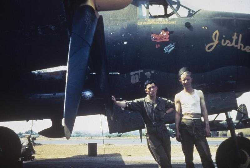 Technical Sergeant George Vasaumper, crew chief of the 387th Bomb Group stands with a colleague and a B-26 Marauder (serial number 41-31677) nicknamed