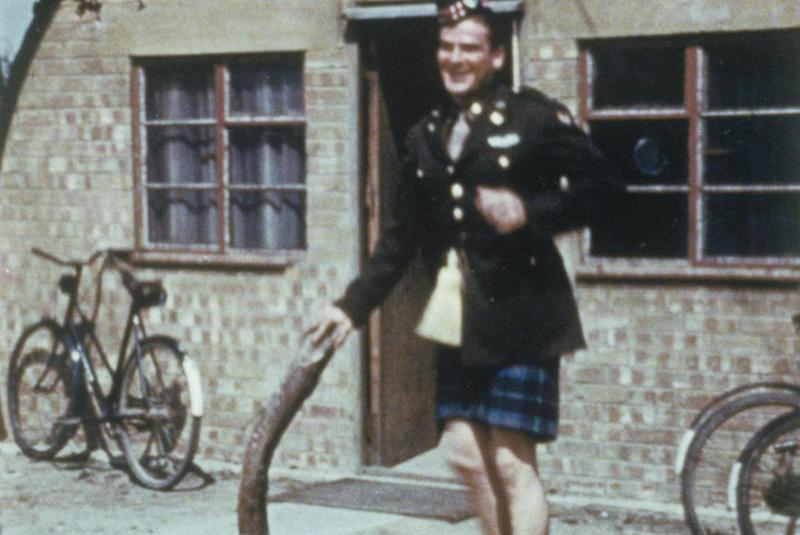 An airman of the 391st Bomb Group wearing a service dress jacket and kilt. Written on slide casing: '391 BG.'