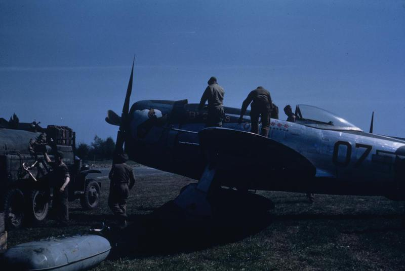 Captain Bloom of the 514th Fighter Squadron, 406th Fighter Group sits in the cockpit of his P-47D serial 44-33353