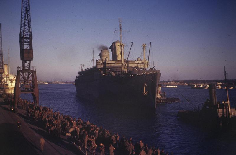 Personnel of the 373rd Fighter Group, and other US enlisted men watch the arrival of the 'USS West Point' at Southampton, which will transport them home. Image via Harold. Written on slide casing: '23/7/45, 'West Point', to load 373 FG men. Southampton.'