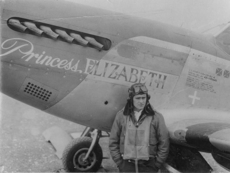 Lieutenant William T Whisner of the 487th Fighter Squadron, 352nd Fighter Group with his P-51 Mustang nicknamed