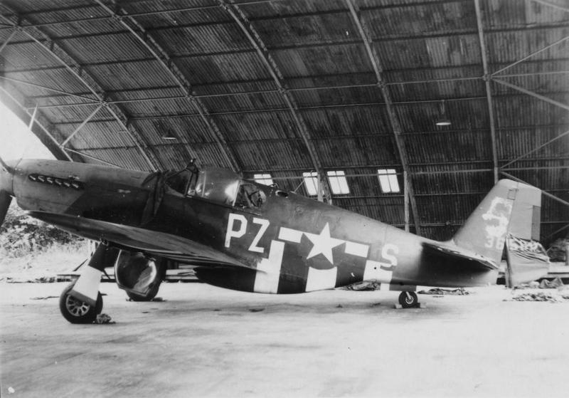 A battled damaged P-51 Mustang (PZ-S) of the 486th Fighter Squadron, 352nd Fighter Group in a hangar at Bodney.