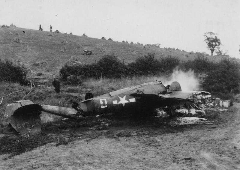 The burning wreck of a P-38 Lightning (serial number 42-67490) of the 495th Fighter Training Group.