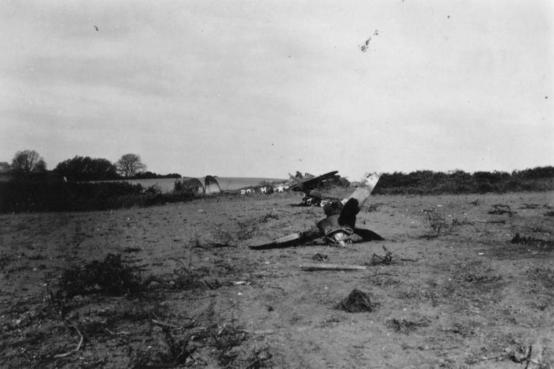 The wreck of a P-38 Lightning (B9-H) of the 554th Fighter Training Squadron, 496th Fighter Training Group. Handwritten caption on reverse: 'B9 is back.'