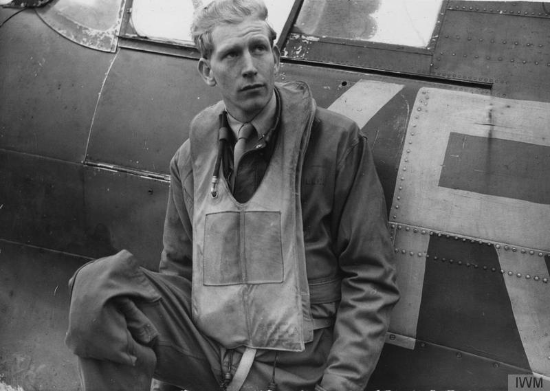 Chesley Peterson, of the 334th Fighter Squadron, 4th Fighter Group, with his Supermarine Spitfire, 30 March 1943. Handwritten caption on reverse: '30-3-43.' Printed caption removed from reverse. On reverse: Sport & General, US Army General Section Press & Censorship Bureau and US Army Press Censor ETO [Stamps].