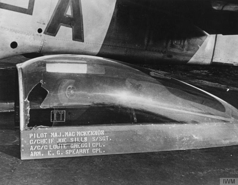 A cockpit cover of a P-51 Mustang of the 4th Fighter Group, flown by Major Mac McKennon, damaged by a 20mm cannon shell. Handwritten on reverse of caption: 'April 16, 45. Mac's canopy when hit by 20mm on Prague show. Source - J. Sills. 310 KP.'