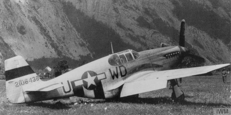 A P-51 Mustang (WD-U, 42-106438) of the 335th Fighter Squadron, 4th Fighter Group, flown by Lieutenant Curtis Simpson, after a forced landing in Switzerland, 19 July 1944.