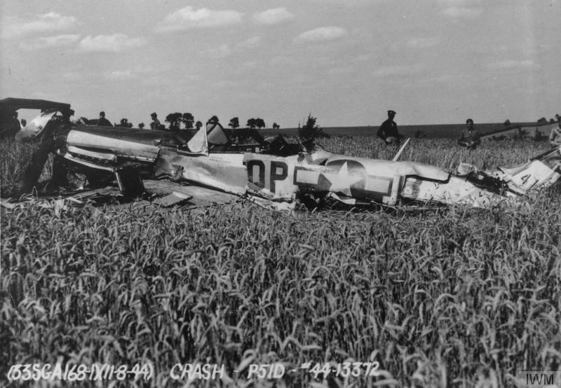 The wreck of a P-51D Mustang (QP-B, 44-13372) of the 334th Fighter Squadron, 4th Fighter Group, flown by of Lieutenant-Colonel James Clark after crash landing during a test flight by Lieutenant Willard G. Gillette. Official caption on image: