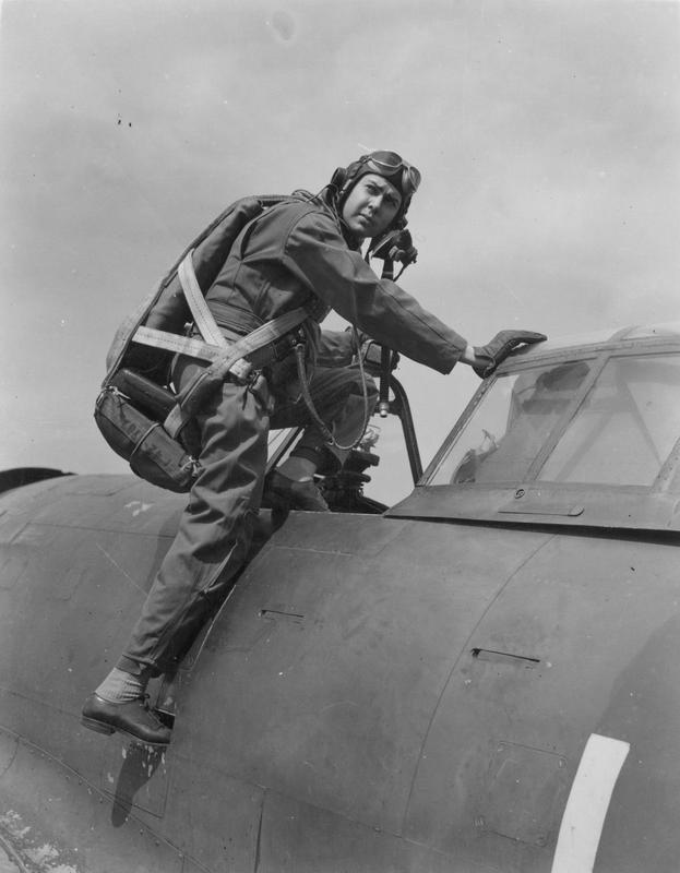 Major Gerald Johnson, of the 56th Fighter Group, climbs into the cockpit of his P-47 Thunderbolt. Handwritten caption on reverse: 'Maj. Gerald Johnson. MIA - France.'