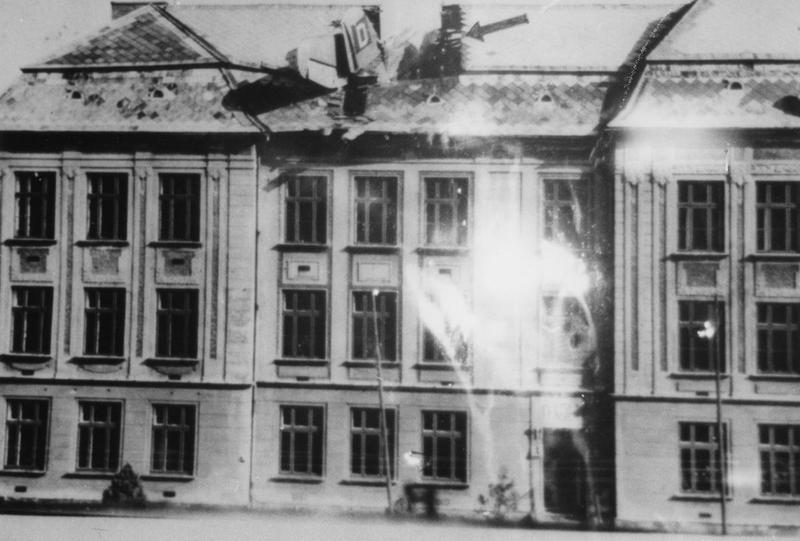 A B-17 Flying Fortress (serial number 42-102657) of the 350th Bomb Squadron, 100th Bomb Group that has crashed into the roof of a building. Handwritten caption on reverse: 'B-17G, 42-102657. 350BS. Crashed 11/9/44. Sgt. J.C. Kluttze. T. Bradshaw.'