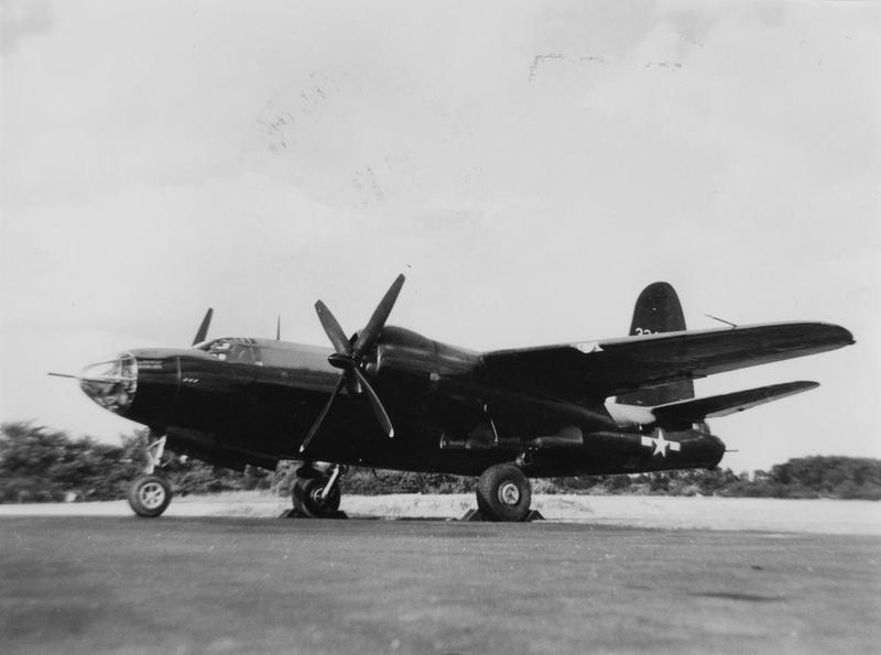 A B-26 Marauder of the 654th Bomb Squadron, 25th Bomb Group, parked on a runway. Handwritten on reverse: '654 BS.'