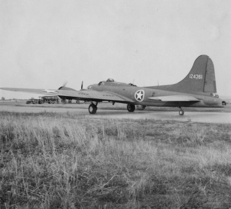A B-17 Flying Fortress (serial number 41-24361) of the 301st Bomb Group prepares for take off. Handwritten caption on reverse: '2-10-42. Chelveston, 301BG.' Printed caption on reverse: 'Flying Fortress Raid French Factory. Associated Press Photo Shows:- A Flying Fortresses takes off for the raid on Meaulte. AP 252181. 5-10-42-N.' On reverse: Associated Press, US Army General Section Press & Censorship Bureau and US Army Press Censor ETO [Stamps].