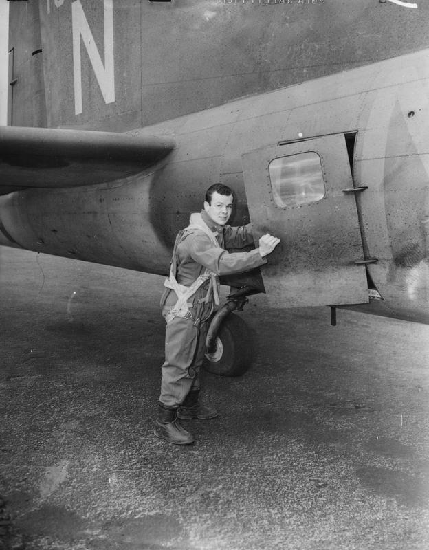 Major William Calhoun of the 303rd Bomb Group climbs into his B-17 Flying Fortress nicknamed