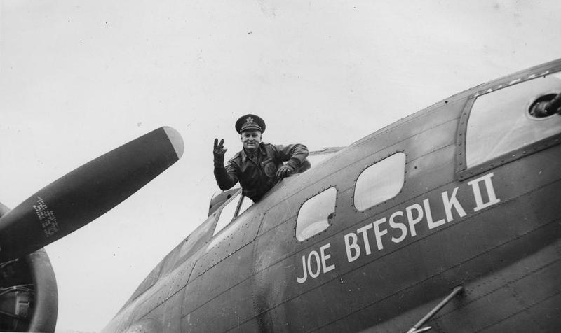 Lieutenant Fort W. Lipe of the 303rd Bomb Group, signals 'V for Victory' from the cockpit of his B-17 Flying Fortress (GN-T, serial number 41-24610 ) nicknamed