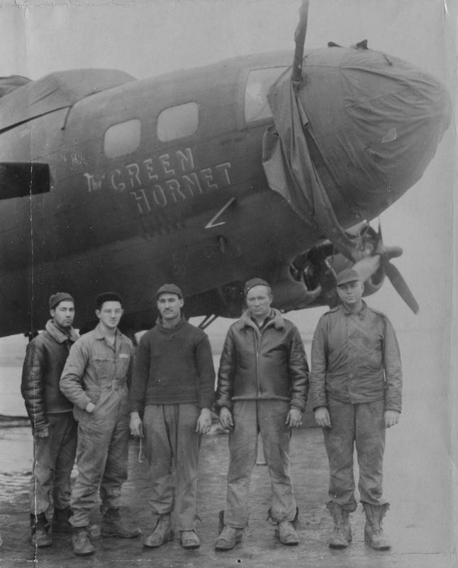 Ground personnel of the 303rd Bomb Group with their B-17 Flying Fortress nicknamed