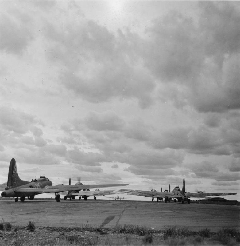 B-17 Flying Fortresses of the 303rd Bomb Group line up for take off. A B-17 (VK-I, serial number 42-3064) nicknamed