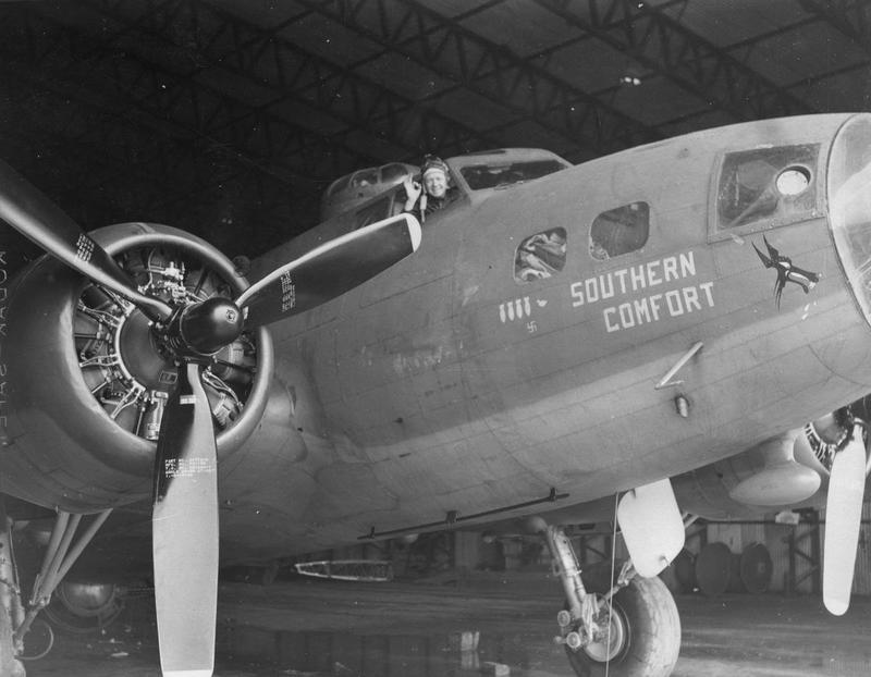 An airman of the 305th Bomb Group in the cockpit of a B-17 Flying Fortress nicknamed