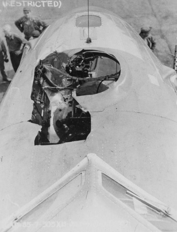 A battle damaged B-17 Flying Fortress (serial number 42-102555) of the 305th Bomb Group. The aircraft was damaged when a 500lb bomb smashed through the nose of the aircraft while flying over the Target on 18 July 1944. Navigator Lieutenant L J Simpson was killed in the accident  Handwritten caption on reverse: '2102353 KY-F- 7/44.'