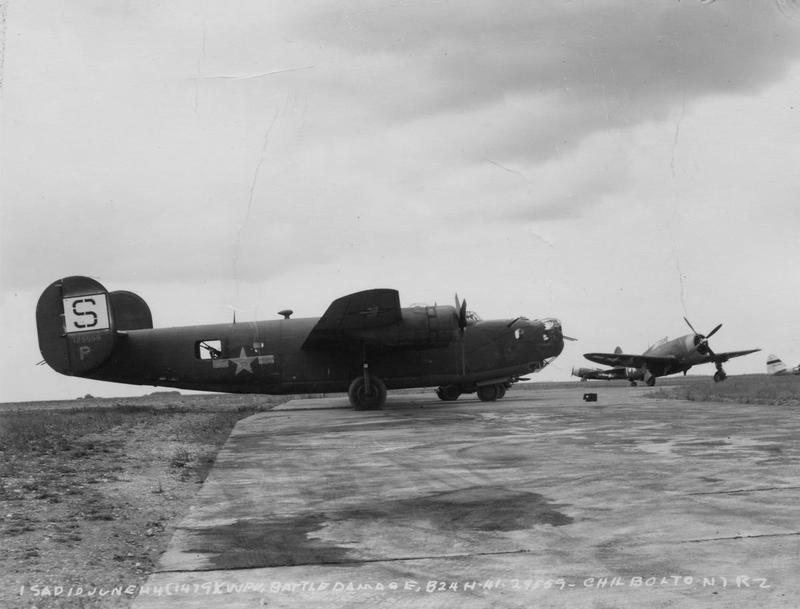 A battle-damaged B-24H Liberator (serial number 41-29559) of the 34th Bomb Group at Chilbolton. Official caption on front: