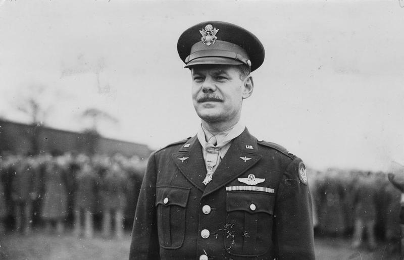 Colonel Leon W. Johnson of the 44th Bomb Group after receiving the Congressional Medal of Honor. Handwritten caption on reverse: '138/RF, WD 140. B/G Leon Johnson with Medal of Honor 22 Nov 1943.' On reverse: Sport & General [Stamp].