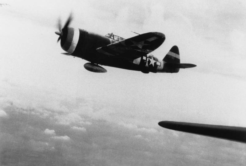 A P-47 Thunderbolt in the colours of the 5th Emergency Rescue Squadron in flight. Handwritten caption on reverse: '28490. Mystery. Has 5 ERS nose colours but not in unit history. Do not appear to have normal D-Day stripes.' UPDATED: 42-8490 is ex 352nd Fighter Group, 486th Fighter Squadron where it was coded PZ-S and assigned to Capt. Stanley G Miles who named it
