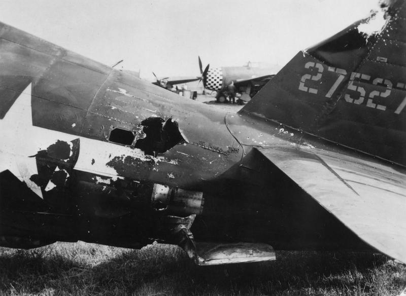 The damaged tail of a P-47 Thunderbolt (serial number 42-75271) of the 353rd Fighter Group