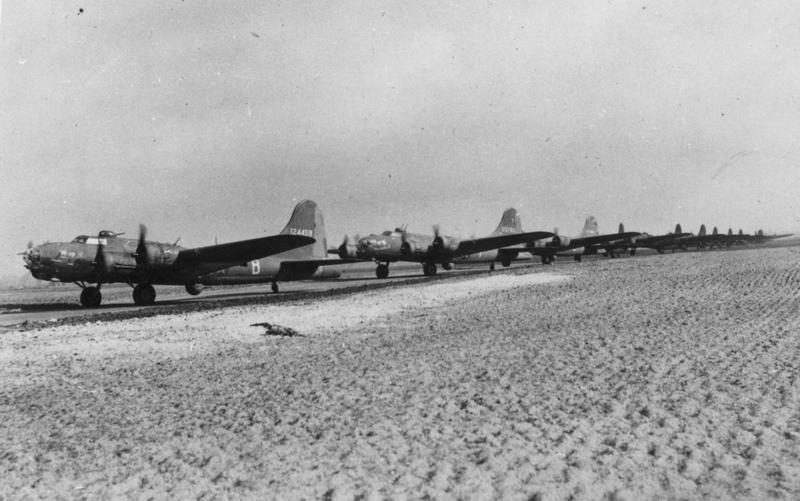 Three B-17 Flying Fortresses (LL-B serial number 41-24459), (LL-F serial number 25763) and (LL-C serial number 41-24484), all of the 401st Bomb Squadron, 91st Bomb Group, line up for take off. Handwritten caption on reverse: '22/3/43. 124459 LL-B, 25763 LL-F, 124484 LL-C. 91BG.' Passed for publication 24 Mar 1943. On reverse: Associated Press Ltd and U.S. Army Press Censor [Stamps]. Print No: 254769.