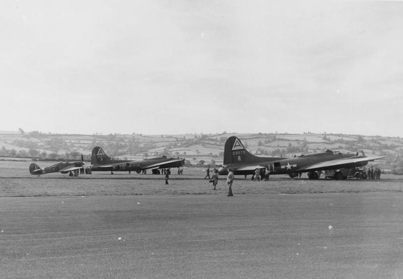 Two B-17 Flying Fortresses (LG-V, serial number 42-29711) and (LL-A, serial number 42-3073) of the 91st Bomb Group with an RAF Hurricane. Image via Merle Olmstead. Handwritten caption on reverse: 'Sept 1943. LG-V, 42-29711, ex-94BG, 322nd BS. LL-A, 42-3073, 401st BS. 91st B.G. Photos probably at Whitchurch.'