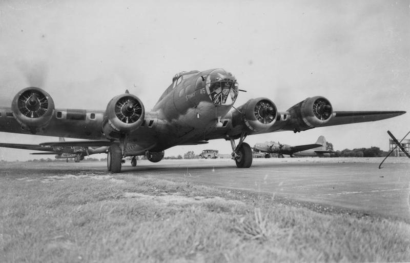 B-17 Flying Fortresses of the 92nd Bomb Group line up for take off, a B-17 nicknamed