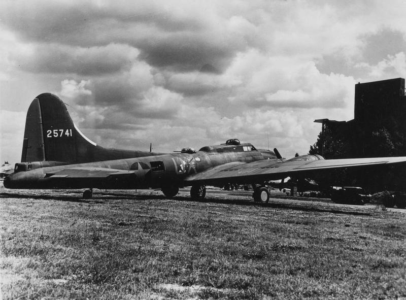 A YB-40 B-17 Flying Fortress ( serial number 42-5741) of the 327th Bomb Squadron, 92nd Bomb Group. Printed caption on reverse of print: '#4397. YB-40 with extra 50 caliber guns. H.'