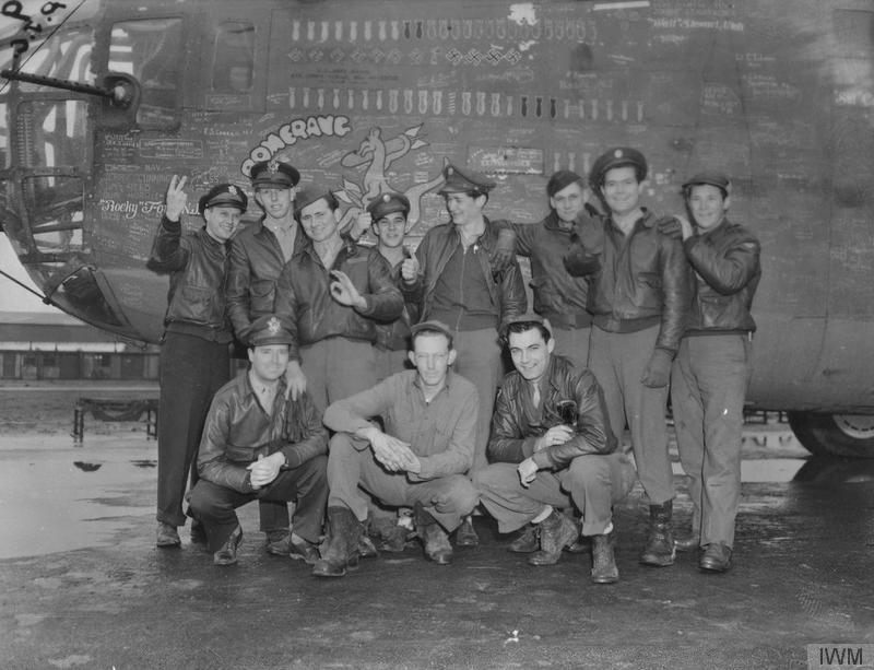 A bomber crew of the 93rd Bomb Group with their B-24 Liberator nicknamed