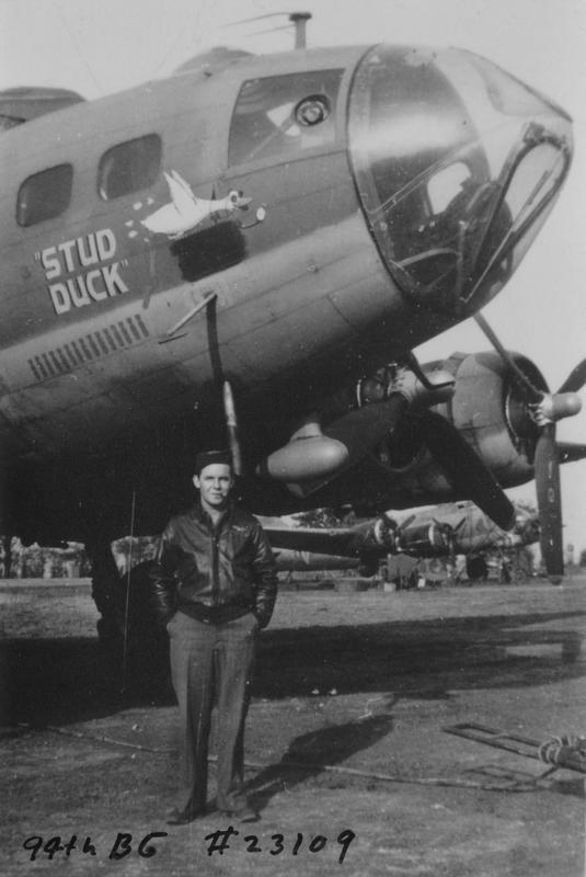 An airman of the 94th Bomb Group with his B-17 Flying Fortress (serial number 42-3109) nicknamed