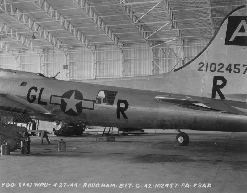 A B-17G Flying Fortress (GL-R, serial number 42-102457) of the 410th Bombardment Squadron, 94th Bombardment Group, is inside a hangar at Bury St. Edmunds (Rougham). Official caption on image: