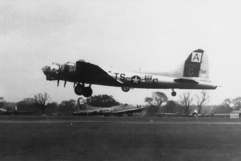 A B-17 Flying Fortress (TS-C, serial number 42-97681) of the 333rd Bomb Squadron, 94th Bomb Group, takes off in front of another B-17 Flying Fortress (CC-Z) of the 569th Bomb Squadron, 390th Bomb Group.