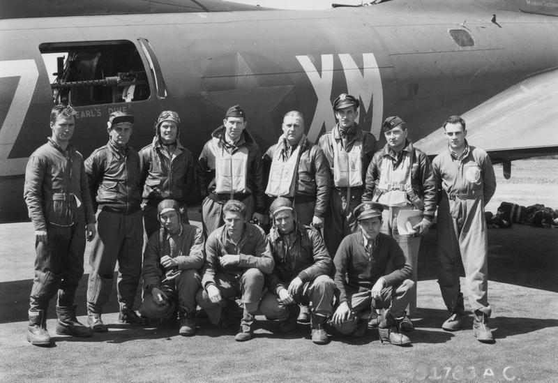 Brigadier-General Fred L. Anderson and a crew of the 94th Bomb Group with their B-17 Flying Fortress (XM-Z) at Bury St. Edmunds (Rougham). 19 May 1943. Printed caption on reverse: '51783 AC- Brig. General Fred L. Anderson with crew of the 94th Bomb Group, 8th Air Force, beside a Boeing B-17 Flying Fortress.  Back row, left to right:  S/Sgt. Jefferson D. Polk, ball turret gunner, Okla. City, Okla.;  S/Sgt. A.W. Hornden[?], top turret gunner;  T/Sgt. Charles H. McNemar, Radio Operator, Weston, W. Va.;  General Fred L. Anderson;  Col. John G. Moore, co-pilot, Los Animas, Col.;  Capt. Kenneth S. Steele, pilot, Santa Rosa, Calif.; Capt. John F. Watters, Group Bombardier, Slema, Ala.;  1st Lt. Robert Schaefer, Navigator, Minn.  Front row, left to right:  S/Sgt. Earl L. Porath, waist gunner, Naleigh, Neb.;  S/Sgt. Eino Asiala, tail gunner, Freda, Mich.;  S/Sgt. Richard H. Lewis, waist gunner, Chicago, Ill.;  and 1st Lt. Martin V. Stanford, bombardier, Kokomo, Ind.  U.S. Air Force Photo.'  Handwritten on reverse: '19/5/43.'
