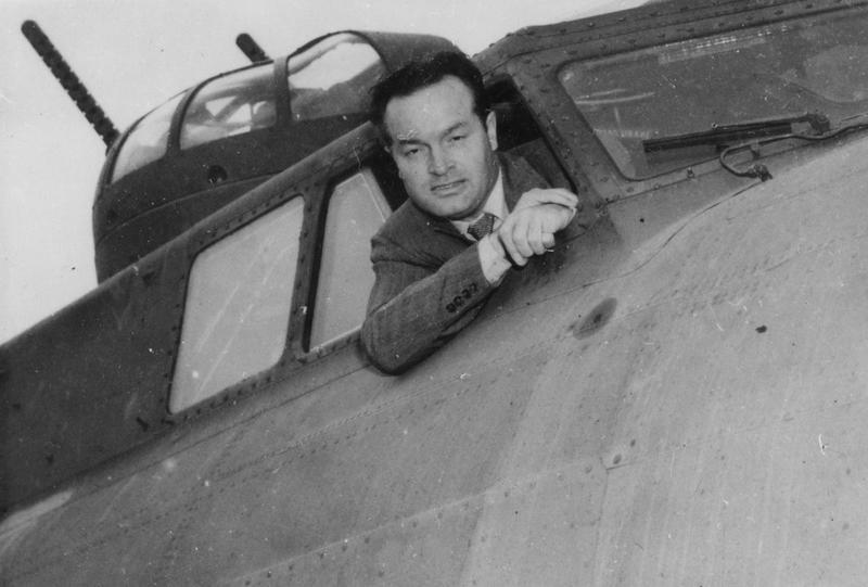 Comedian Bob Hope in the cockpit of a B-17 Flying Fortress, during a visit to the 94th Bomb Group.