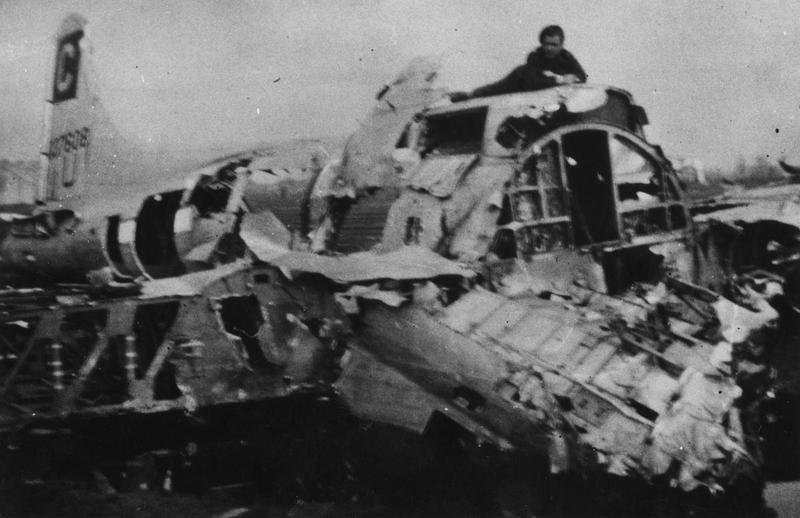 The wreckage of a B-17G Flying Fortress (serial number 43-37608) of the 96th Bomb Group that crash landed in Holland. Handwritten caption on reverse: '43-37608. RNAF.'