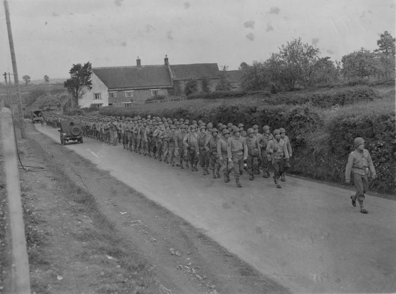 Handwritten caption on reverse: '441st Troop Carrier Group, US Army, Merryfield, England. We dropped the 101st Paratroop Division at Normandy. This photo is one of our squadrons. '