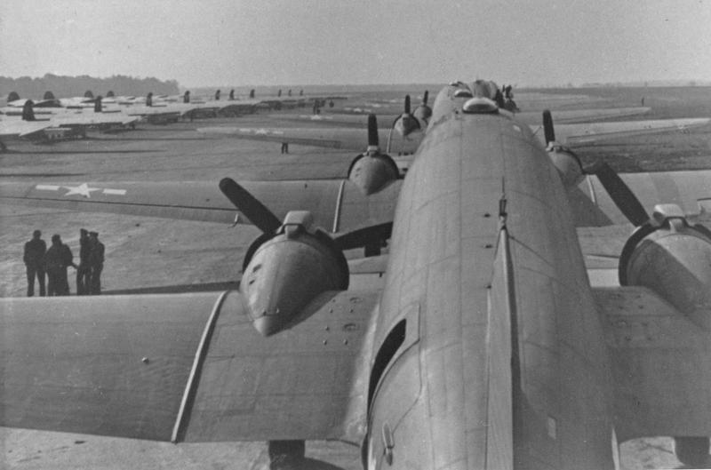 C-47 Skytrains of the 313th Troop Carrier Group line up for take off at Folkingham. Handwritten caption on reverse: 'C-47s, 313 TCG, Folkingham, Sept 1944. D. Benfield. Air 9th Endpapers.'