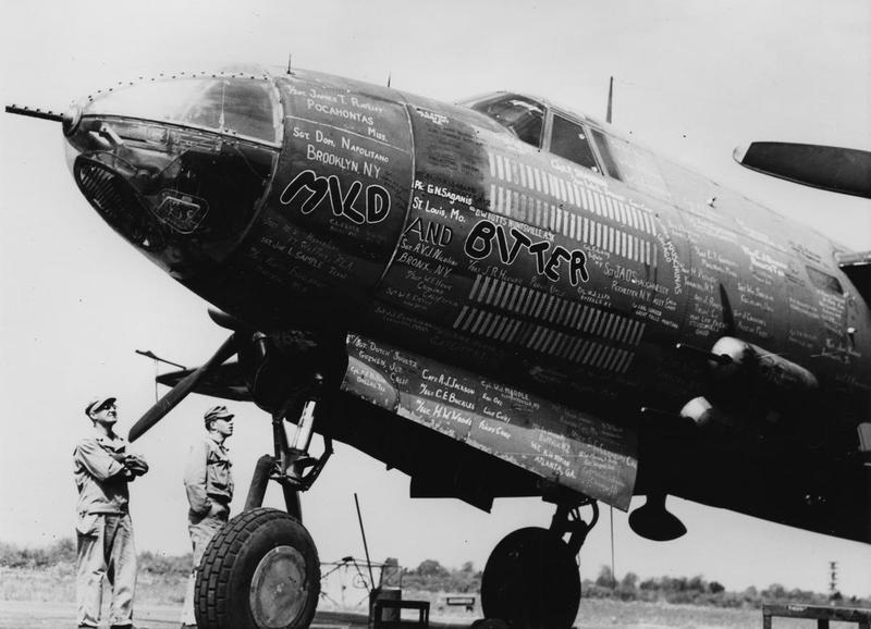 Airmen of the 322nd Bomb Group admire the nose art of a B-26 Marauder nicknamed
