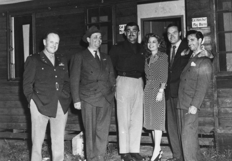 Colonel Hatcher of the 351st Bomb Group with comedian Bob Hope, Hollywood actor Clark Gable and guests. Handwritten caption on reverse: '7. Col. Hatcher and guests during Bob Hope show.'  Left to right:  Colonel William Hatcher, Jack Pepper, Captain Clark Gable, Frances Langford, Bob Hope and Tony Romano.