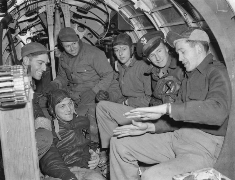 A bomber crew of the 351st Bomb Group inside a B-17 Flying Fortress . Passed for publication 1 Jan 1944. Printed caption on reverse: 'Five