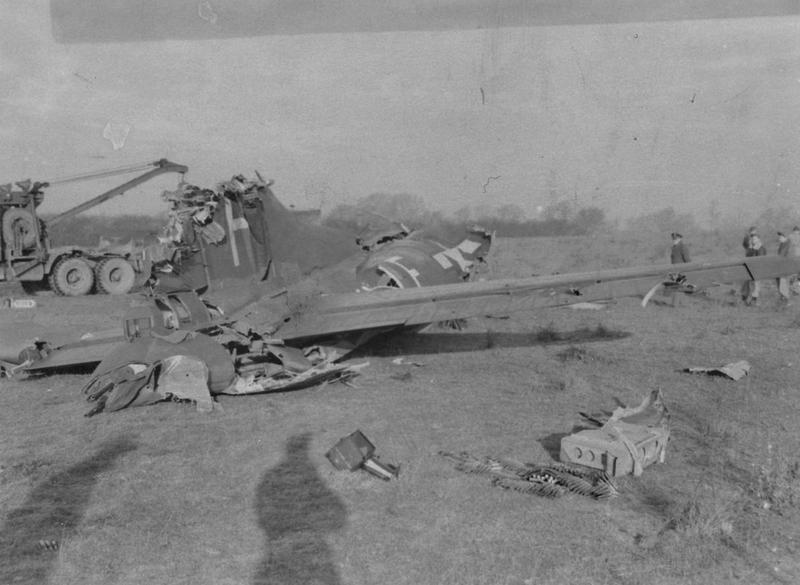 The wreck of a B-17 Flying Fortress (LF-F, serial number 43-79180) of the 379th Bomb Group, damaged in a mid air collision. Not To Be Published 6 Jan 1944, Passed for publication 1 Jul 1945. Handwritten caption on reverse: 'LF-F, 379180.' Printed caption on reverse: 'Twenty-Eight Die When Three Fortresses Crash In The Take-Off For Raid On Kiel. Twenty-eight airmen were killed when three Flying Fortresses crashed together while forming up for yesterday's (January 5) raid on Kiel. the crash occurred at 2,000ft. and all three planes exploded when they hit the ground with full bomb-load. The ten crew-members on two of the aircraft died before reaching the ground. Three men escaped from the last plane but one of these died later. Associated Press Photo Shows:- General view of the wreckage of one of the three Flying Fortresses which crashed with full bomb-load while forming up to take part in yesterday's (January 5) raid on Kiel. IRV 263695. 6-1-44-Y.' Censor no: 298986. On reverse: Associated Press, Ministry of Information, US Army General Section Press & Censorship Bureau Passed For Publication and US Army General Section Press & Censorship Bureau/Press Censor ETO Not To Be Published [Stamps].