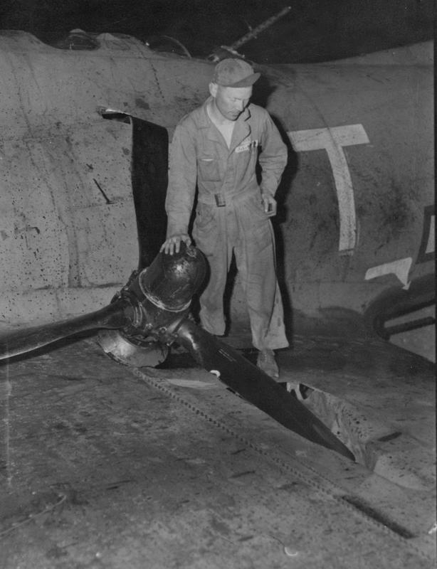 Master Sergeant James L. Smith a crew chief of the 379th Bomb Group inspects the propellor of a B-17 Flying Fortress nicknamed