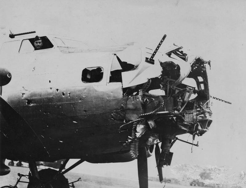 Major Alex B. Andrews, an 8th Air Force HQ special observer, in the cockpit of a damaged B-17 Flying Fortress nicknamed