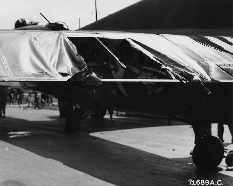 The damaged wing of a B-17 Flying Fortress (serial number 42-29886) of the 379th Bomb Group. Printed caption on reverse: '71689 AC - The wing of the Boeing B-17