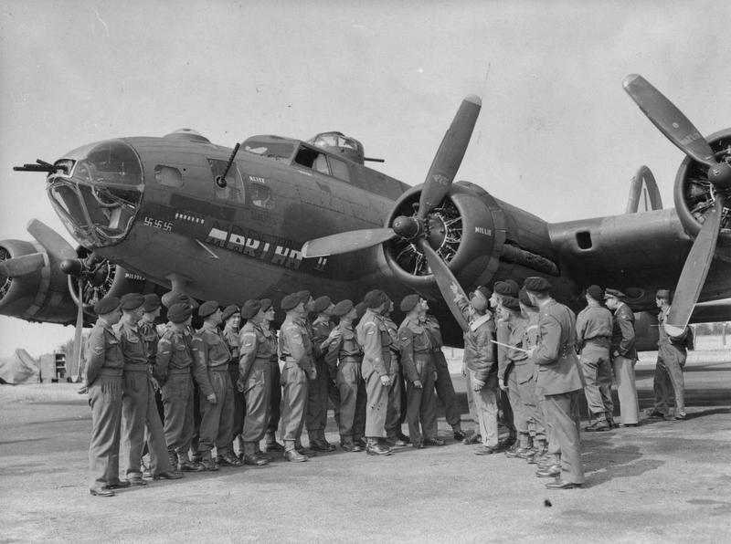 Personnel of the 55th Royal Armoured Corps with a B-17 Flying Fortress nicknamed